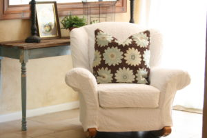 chair slipcover made from a queen matelasse bedspread