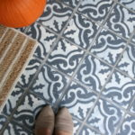 I painted faux encaustic/cement tile on my front porch